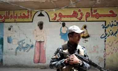 Soldado das forças iraquianas em Mossul Foto: CHRISTOPHE SIMON / AFP