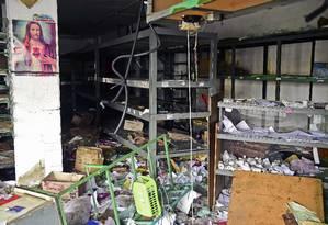 Supermercado foi saqueado em Valencia, no estado de Carabobo, na Venezuela Foto: RONALDO SCHEMIDT / AFP