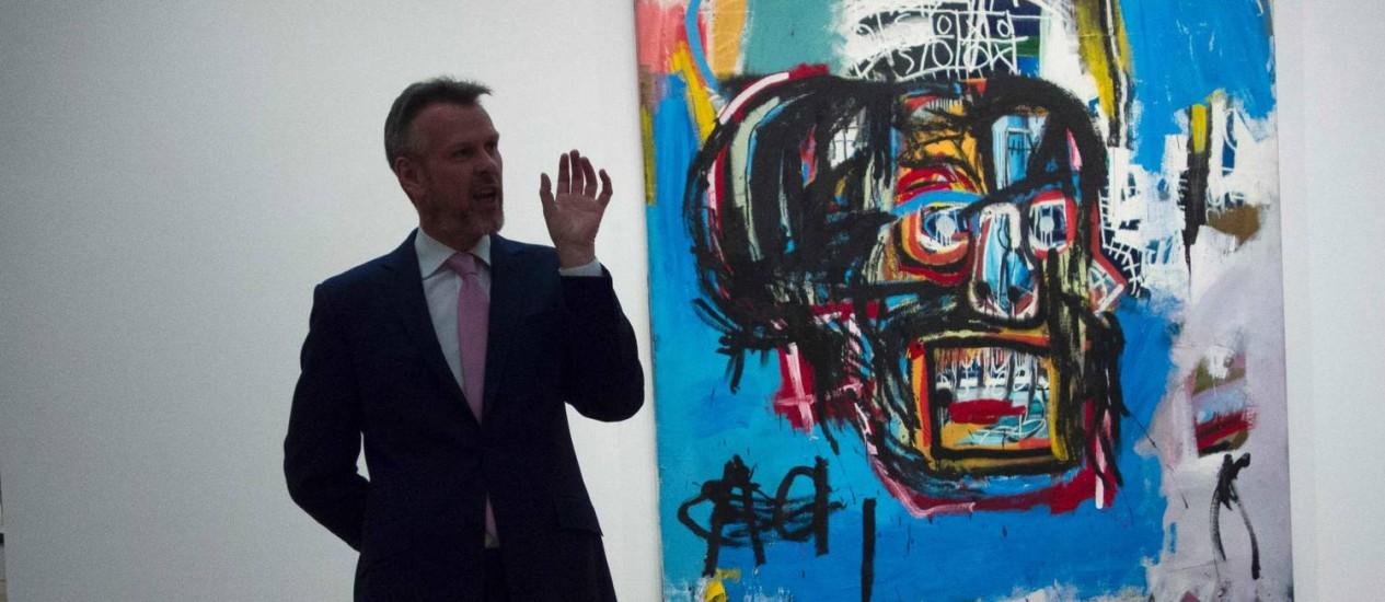 A obra de Basquiat atingiu valor recorde de US$ 110,5 milhões Foto: DON EMMERT / AFP
