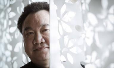 """""""Antes de conhecer o Salgado, eu o reverenciava como um deus. Quando o encontrei, no entanto, pude ver que é uma pessoa muito simples"""", revelou Zhong Weixing Foto: Leo Martins / Agência O Globo"""