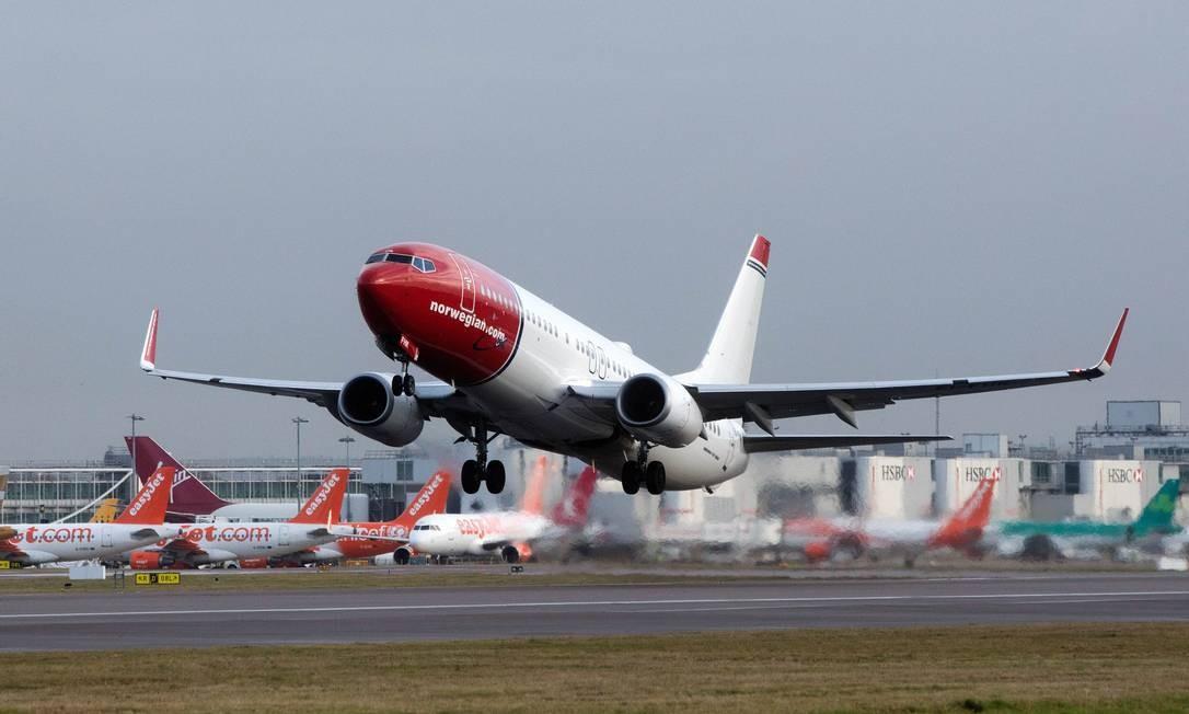 Para além da Europa. Avião da 'low cost' norueguesa Norwegian: empresa fez primeiro voo fora da Europa em 2013 Foto: Simon Dawson / Simon Dawson/Bloomberg News/10-1-2017