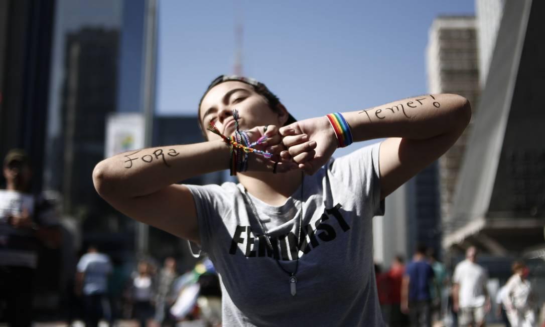 Evento também tem protestos contra o presidente Michel Temer MIGUEL SCHINCARIOL / AFP