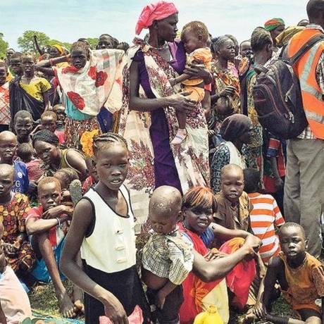 Refugiados no Sudão do Sul à espera de comida: aumento da população global trará problemas tanto na esfera ambiental quanto na social Foto: Sam Mednick/AP