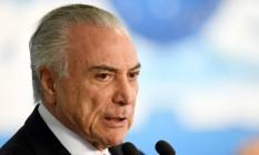 O presidente Michel Temer discursa no Palácio do Planalto Foto: EVARISTO SA / AFP