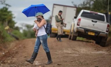 Guerrilheiros desmobilizados vivem em área onde Santos e Timochenko oficializam fim oficial das Farc Foto: RAUL ARBOLEDA / AFP
