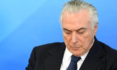 O presidente Michel Temer: denunciado pelo procurador-geral Foto: Evaristo Sá / AFP