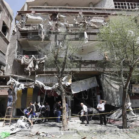 Prédios ficaram destruídos após atentado Foto: LOUAI BESHARA / AFP