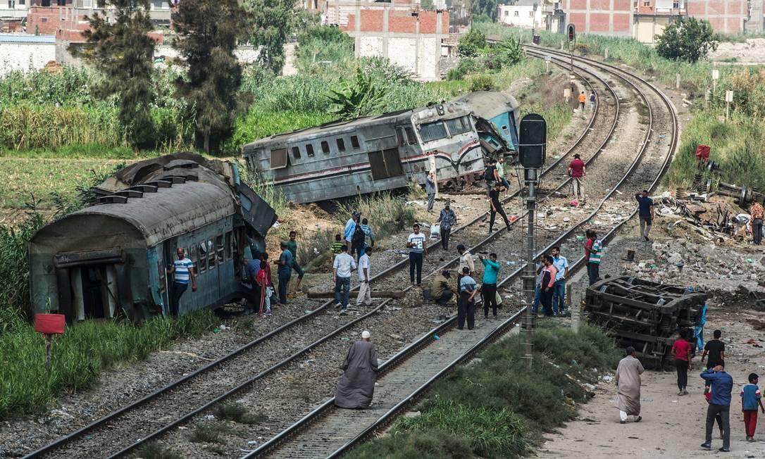 Vagões saíram dos trilhos por causa da forte colisão KHALED DESOUKI / AFP