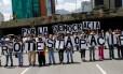 Manifestantes opositores protestam contra o presidente da Venezuela, Nicolás Maduro