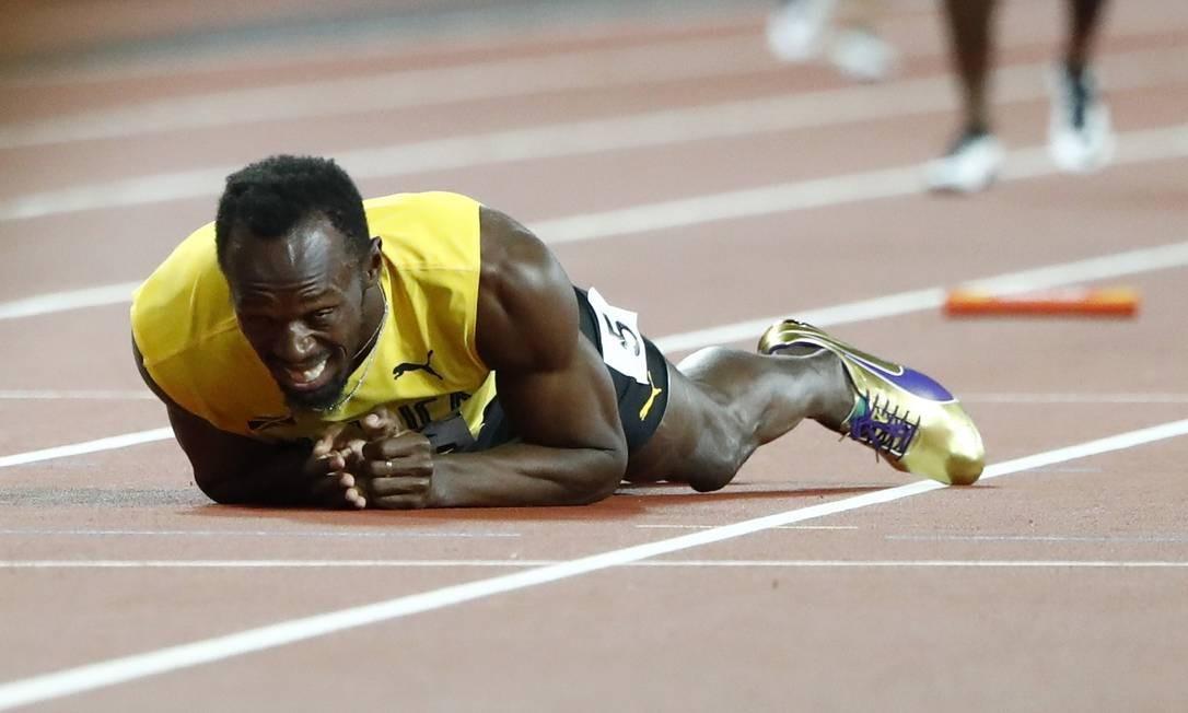 A frustração de Bolt ao sentir a lesão no adeus às pistas LUCY NICHOLSON / REUTERS