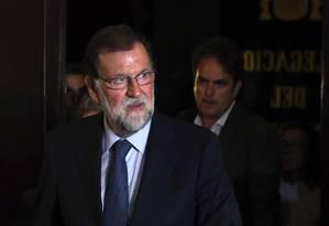Mariano Rajoy chega para reunião após ataque terrorista em Barcelona Foto: LLUIS GENE / AFP