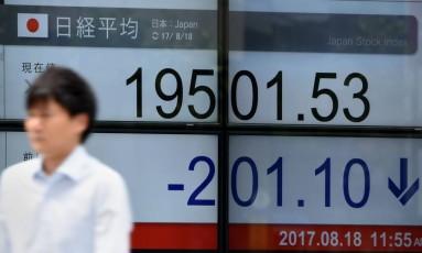Bolsa do Japão fechou em queda de mais de 1%. Foto: Toru Yamanaka/AFP