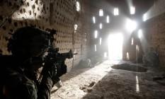 Soldados americanos disparam contra talibãs na província de Kandahar Foto: BAZ RATNER / REUTERS