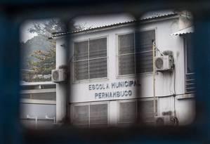 Recuperação. A Escola Municipal Pernambuco é uma das que suspenderam atividades por causa da violência Foto: Guito Moreto / Agência O Globo 18-08-2017