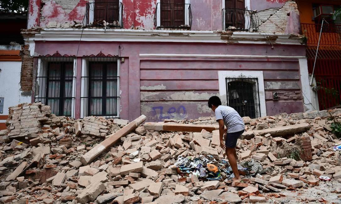 Casa fica destruída por terremoto em Juchitan de Zaragoza, no estado de Oaxaca Foto: RONALDO SCHEMIDT / AFP