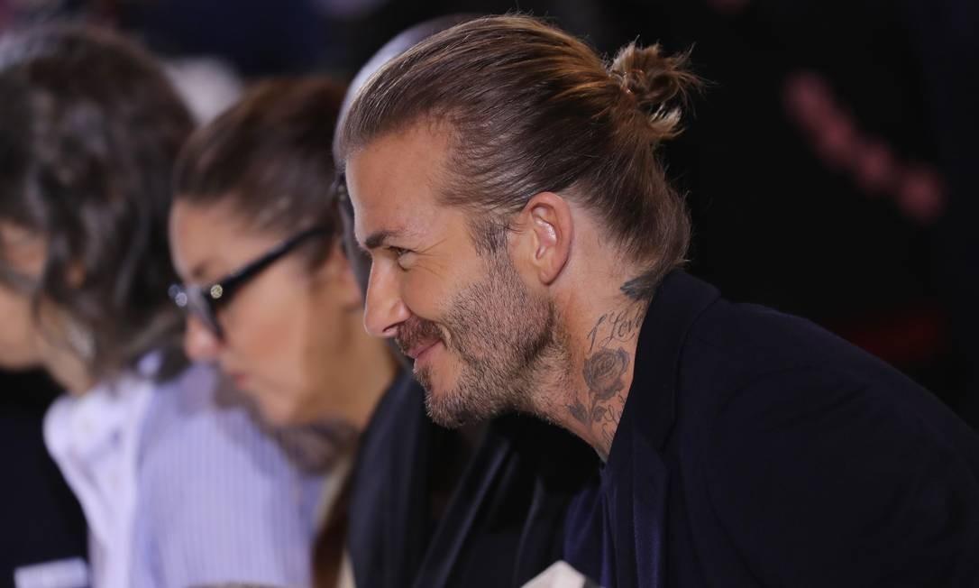 Beckham prendeu os cabelos louros para o desfile, fazendo o maior estilo JP Yim / AFP