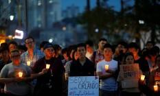 População em vigília após atentato em Orlando Foto: Kim Hong-Ji / Reuters