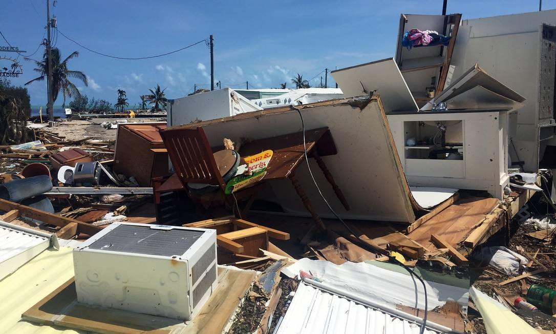 Casas ficaram arrasadas após a passagem do Irma, que foi rebaixado na segunda-feira para tempestade tropical. O fenômeno seguia nesta terça para o Noroeste do território americano, provocando inundações e cheias de rios Foto: Henrique Gomes Batista / .