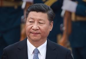 Xi Jinping, presidente da China, que antes mantinha tom conciliatório adotou sanções Foto: NICOLAS ASFOURI / AFP