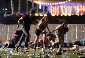 Espectadores de festival correm após tiros Foto: David Becker / AFP
