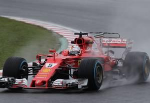 Sebastian Vettel, da Ferrari Foto: KIYOSHI OTA / Kiyoshi Ota/AFP