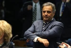 O senador Aécio Neves, que teve o mandato suspenso por ordem do STF: parlamentares têm, historicamente, espírito de corpo Foto: Ailton de Freitas/19-9-2017