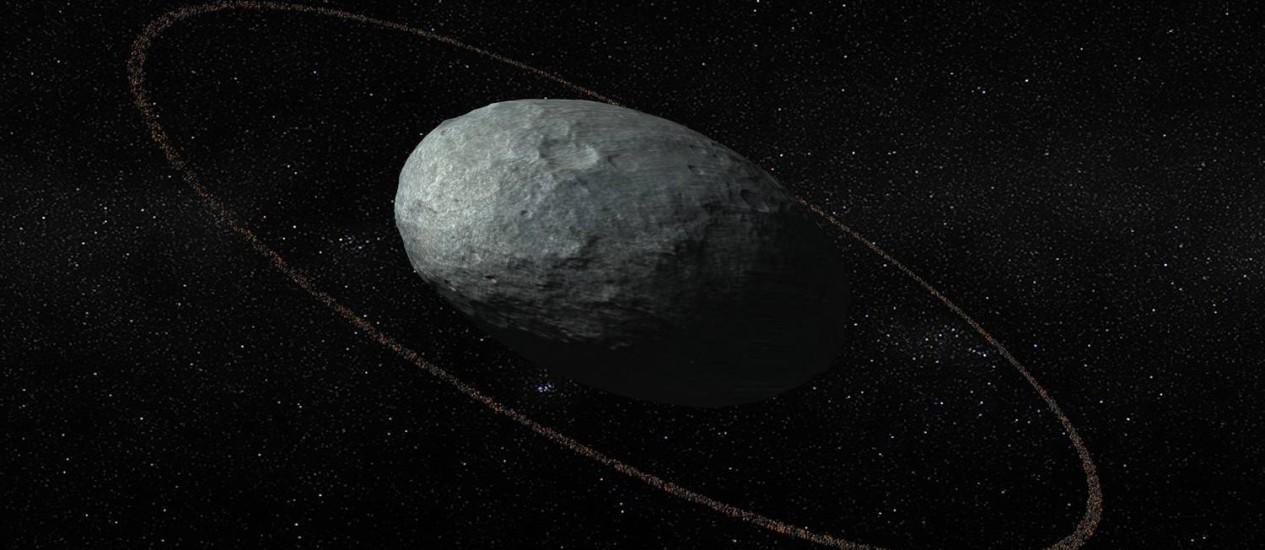 Ilustração mostra o anel de detritos em torno do planeta-anão Haumea Foto: Divulgação/Instituto de Astrofísica da Andaluzia
