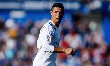 O Real Madrid de Cristiano Ronaldo pega o Tottenham nesta terça-feira Foto: OSCAR DEL POZO / AFP