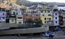 Policiais militares na Rocinha: guerra na favela completou um mês nesta terça-feira Foto: Uanderson Fernandes / Agência O Globo
