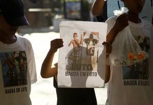 Protesto pela morte de Herinaldo Vinicius, de 11 anos, morto por tiros na favela do Caju, no Rio Foto: Marcelo Carnaval / Agência O Globo / 24-9-15
