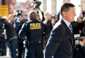 Mudança de lado. Flynn reconheceu que mentiu no inquérito e se comprometeu a colaborar com as investigações sobre as ligações da campanha de Trump com a Rússia Foto: CHIP SOMODEVILLA/AFP