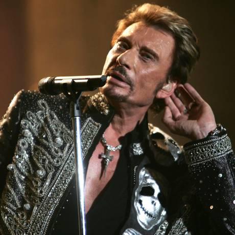 O cantor francês Johnny Hallyday durante show em Paris em 2006 Foto: FRED DUFOUR / AFP