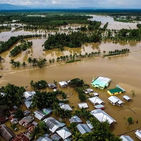 Visão geral de uma área inundada na ilha de Mindanao após passagem de tempestade tropical nas Filipinas Foto: FERDINANDH CABRERA / AFP