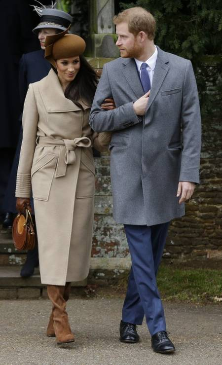 Mais de Harry e Meghan Markle, que vestiu um trench coat da marca canadense Sentaler Foto: Alastair Grant / AP