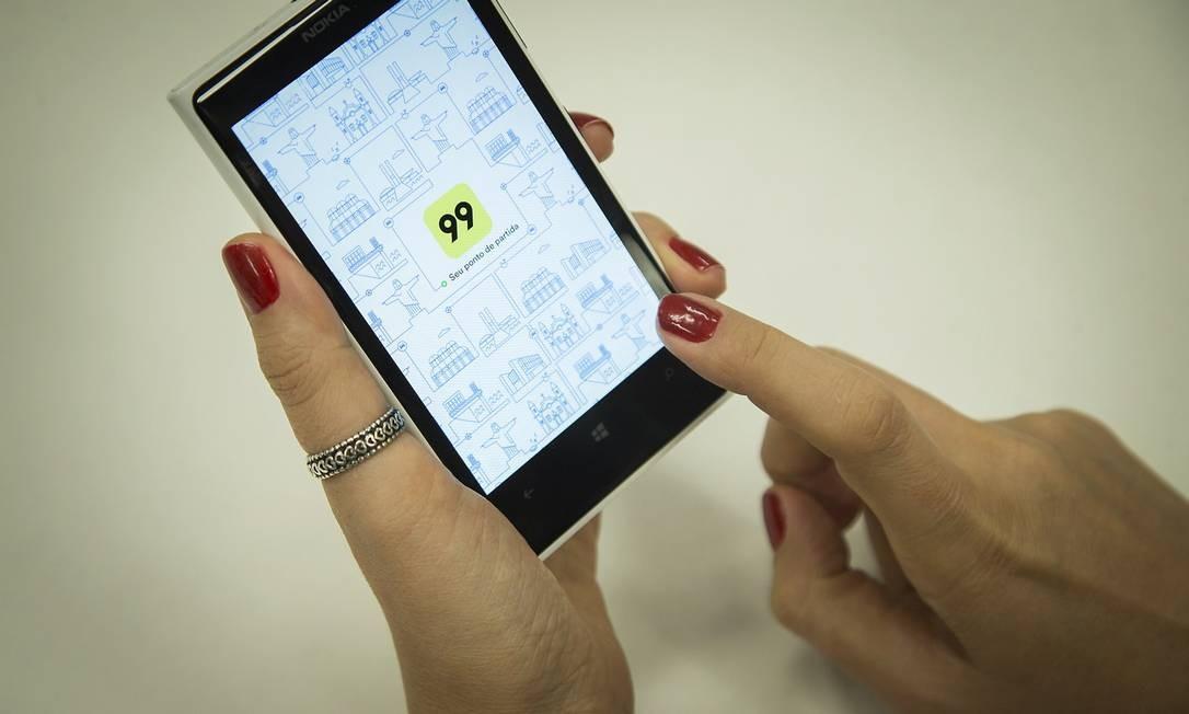 plicativo 99 Taxi foi vendido para um grupo chinês. Foto: Guito Moreto / Agência O Globo