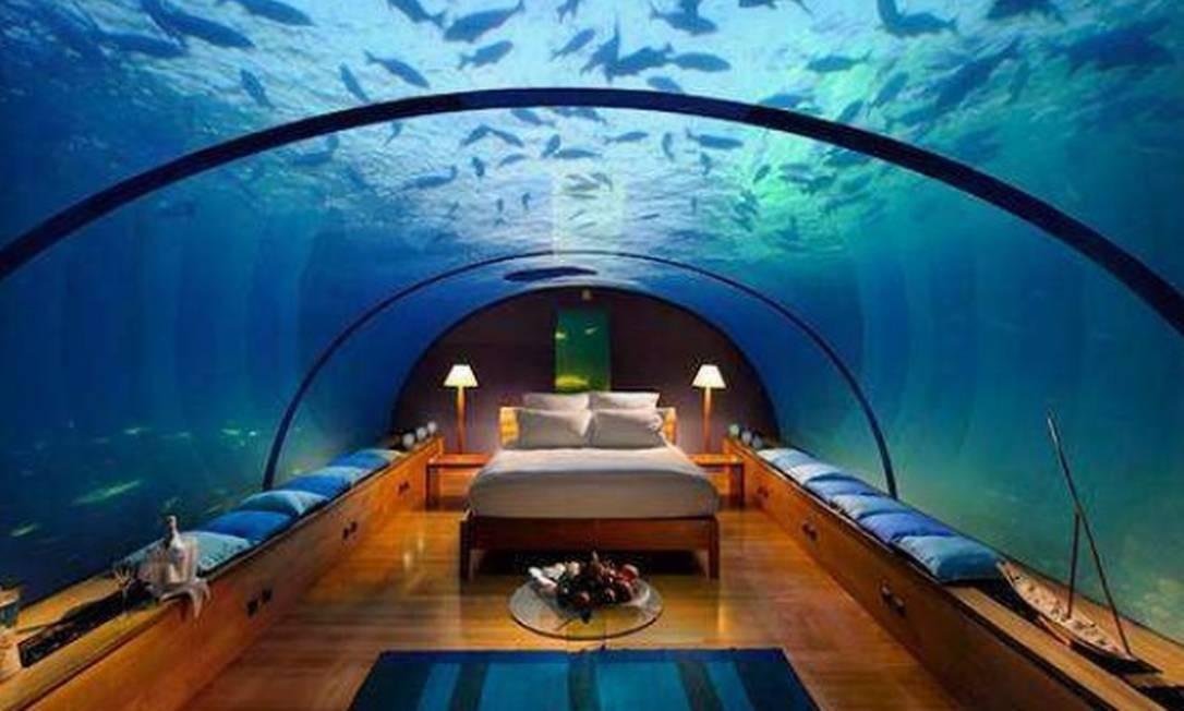 A suíte Poseidon, no Atlantis The Palm, em Dubai: debaixo d'água, na companhia de peixes Foto: Divulgação