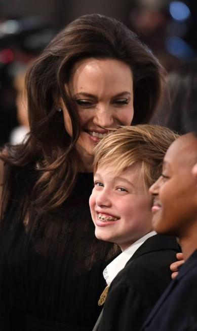 Angelina parece se divertir com as filhas ANGELA WEISS / AFP