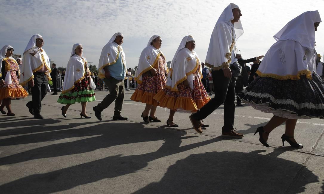 Grupo de freiras com roupas tradicionais esteve na missa rezada por Francisco no parque O'Higgins Foto: Alessandra Tarantino / AP