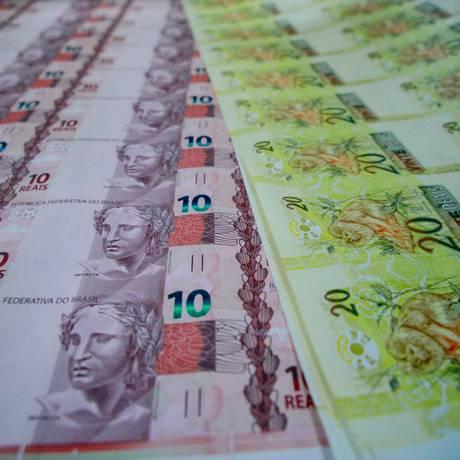 Fabricação de novas notas de 10 e 20 reais na Casa da Moeda Foto: Pedro Kirilos/Agência O Globo/24-07-2012