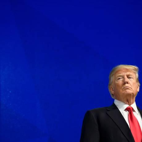 Presidente americano durante discurso em Davos Foto: FABRICE COFFRINI / AFP