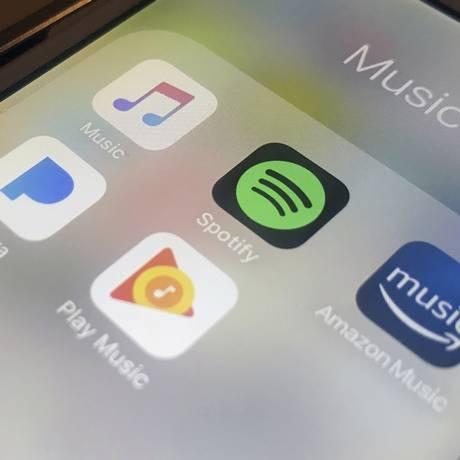 O Spotify e algumas das principais plataformas de streaming, em aplicativos para celulares Foto: Jenny Kane / AP
