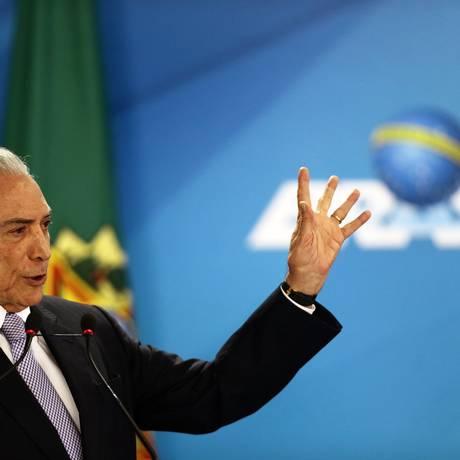 O presidente Michel Temer em cerimônia de lançamento do aplicativo de Documento Nacional de Identificação (DNI) Foto: Jorge William / Agência O Globo
