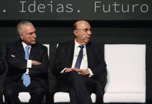 O presidente Michel Temer, ao lado do ministro da Fazenda, Henrique Meirelles, durante evento da Caixa Foto: Givaldo Barbosa/Agência O Globo/01-02-2018
