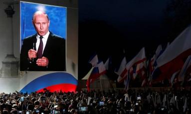 O presidente russo, Vladimir Putin, fez um rápido discurso nas comemorações pelo quarto aniversário da anexação da Crimeia Foto: Maxim Shemetov / REUTERS