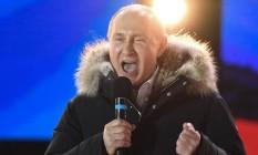 Vladimir Putin discursa em evento que celebra o quarto aniversário de anexação da Criméia, na Praça Vermelha, em Moscou Foto: KIRILL KUDRYAVTSEV / AFP