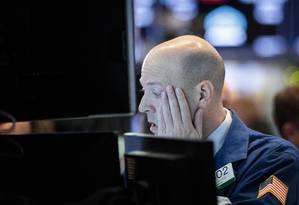 Operador da Bolsa de Nova York Foto: Drew Angerer / AFP