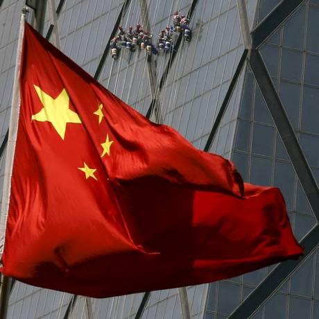 Bandeira da China em prédio comercial de Pequim. Foto: Kim Kyung-Hoon / Reuters