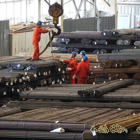 Trabalhadores em fábrica da Dongbei, em Dalian, na província de Liaoning. Foto: Reuters