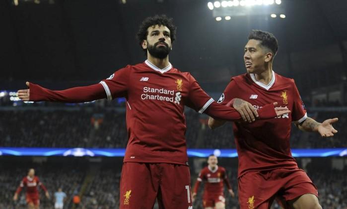 Liverpool vence o city de novo e vai s semifinais da liga dos salah comemora com firmino um dos gols do liverpool sobre o manchester city rui vieira ap stopboris Images