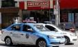 Loja na Rua Conde de Bonfim, na Tijuca, assaltada nesta quinta-feira Foto: MARCOS DE PAULA / Agência O Globo